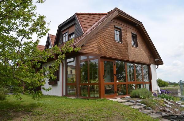 TITELBILD - Haus mit Wintergarten